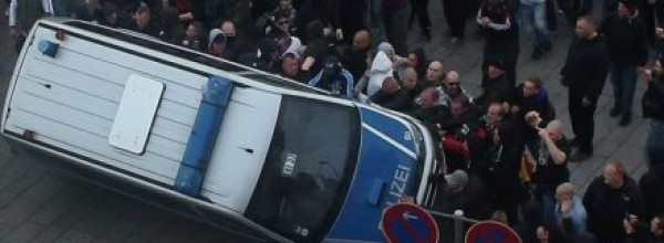 Cologne:  Footall hooligans protesting against Islamist extremism clash with German police